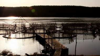 Sturgeon cages at sunset — Stockvideo