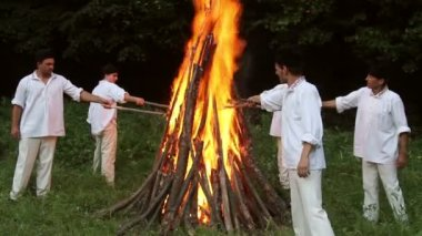 People of the village practice a pagan ritual of cleansing fires — Stock Video