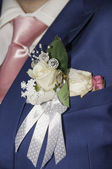 Pinning the Groom with boutonniere flowers — Stock Photo