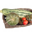 Freshly harvested vegetables in the old basket — Stock Photo #52564021