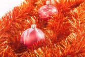 Red Christmas balls on the background of red tinsel  — Stock Photo