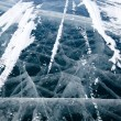 Cracked texture of ice on baikal lake in winter — Stock Photo #54308175