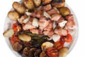 Meat with potatoes, eggplants, tomatoes, onions and peppers on t — Photo