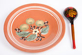 Russian traditional rustic ceramic plate and wooden spoon — Stock Photo
