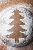 Christmas tree drawn with flour on the dough — Stockfoto