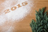 Inscription 2015 on flour and Christmas tree on a wooden table — Stock Photo