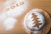 Inscription 2015 on flour and Dough patterned Christmas treeon a — Stock Photo