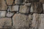 Natural stones are folded in wall. Background. — Stockfoto