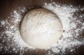 Dough on a wooden table. slightly tinted — Stock Photo