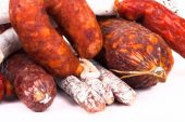 Several types of sausages on a light background — Stock Photo