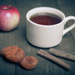 Cup of tea on old wooden table with two apples, dried apricots a — Stock Photo #59152409