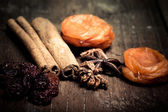 Cinnamon, raisins, dried apricots on a wooden table.Shallow dept — Stock Photo