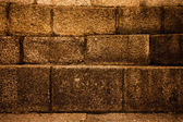 Natural stones are folded in wall. Background.  — Stock Photo
