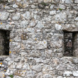 Windows in the old stone wall — Stock Photo #60187915