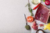 Stillife with a piece of jamon on marble table with space for te — Stock Photo