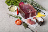 Stillife with a piece of jamon on marble table — Stock Photo