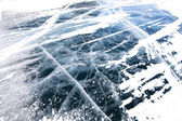 View of beautiful drawings on ice from cracks and bubbles of dee — Stock Photo