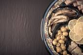 Assorted fish on a plate on a dark background. With space for te — Stock Photo
