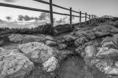 Wooden fence on the edge of Europe. Sunset. black and white — Stock Photo