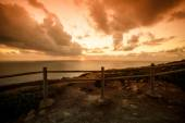 Wooden fence on the edge of Europe. Sunset. tinted — Stock Photo