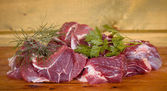 Fresh uncooked beef meat slices over wooden cutting board ready — Stock Photo