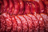 The background - detail of sliced salami — Stock Photo