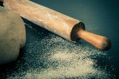 Flour, rolling pin and dough for pie. Toned — Stock Photo