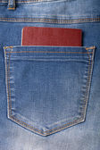 Fickan på jeans med dokumentet. Trasa bakgrund — Stockfoto