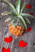 Many Valentine hearts with ananas on the old wooden table — Стоковое фото