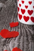 Valentine hearts and cup of tea on the old wooden table — Стоковое фото