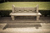 Stone bench in a city park. Garden architecture. tinted — Stock Photo