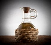 Bottle with braided filled with olive oil. vignetting — Stock Photo