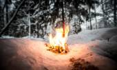 Bonfire on a snowy clearing in the woods. Toned — Stock Photo