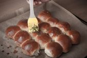 Freshly baked rolls smeared garlic butter and dill — Stock Photo