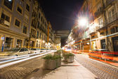 Cars, houses and lights in the street the night Porto — Stockfoto