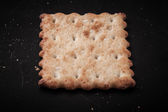 Cookie on the old black shabby background. Toned — Stock Photo