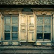 Windows with shutters, patterned on the wall of the old wooden h — Stock Photo #62696905