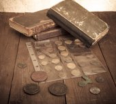 Vintage books and coins on old wooden table. Toned — Stockfoto