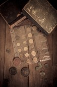 Vintage books and coins on old wooden table. Toned — Foto Stock