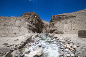 Tajikistan. Mountain stream flowing down the canyon with the bar — Photo