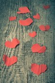 Many Valentine hearts on the old wooden table. Toned. — Φωτογραφία Αρχείου