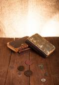 Vintage books and coins and spectacles on old wooden table. Tone — ストック写真