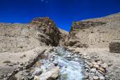 Tajikistan. Mountain stream flowing down the canyon with the bar — Foto Stock
