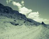Tajikistan. Pamir highway. Road to the clouds. Toned. — Stock Photo
