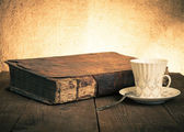 Cup of coffee, old books on the old wooden table. — Stock Photo