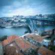 Red tiled roofs, metal bridge, old houses and the river Douro in — Stock Photo #64314139