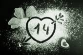 14. Heart with arrow on the flour on the black table. Cookies an — Stockfoto