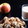 Small cookies in the Turkish bowl, apple and glass of milk on a — Stock Photo #65302687