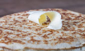 Small piece of butter on stack of Russian pancakes - blini — Stock Photo