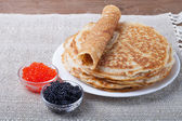 Russian pancakes - blini with red and black caviar — Stock Photo